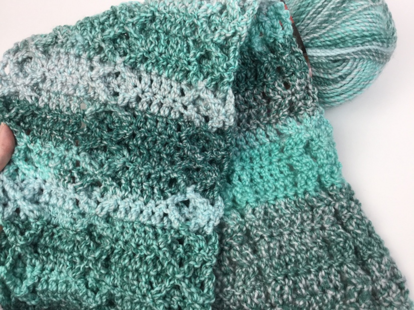 Both sides of the free crochet scarf pattern Rustic Diamond Scarf from Hooked for Life.